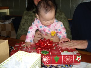 Elise opening presents. She always gets presents.