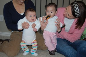 Dayton (about two months old) and Elise (8 months old); They were wearing the same size onesies, 0-3 months.