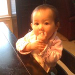 Her left hand needed help getting the food to her mouth.