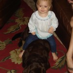 Isla riding her dog, Fran