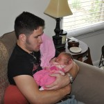 Andrew holding his niece, Vivian