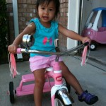 Enjoying her new bike from Uncle Tim