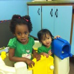 Hope and Elise playing in the playroom