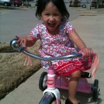 Having fun on her bike