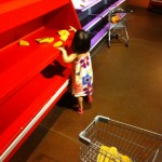 Filling up her shopping cart