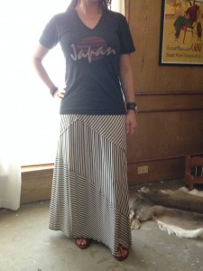 7.26 - Graphic v-neck tee, black and white striped maxi, brown leather sandals, and leather accessories
