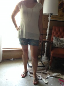 8.9 - An open weave ivory sweater, boyfriend cut off jean shorts and gold accessories
