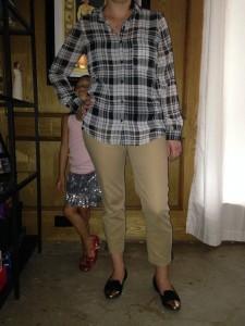 Black and white plaid silk shirt, khaki pants, black gold capped toed flats