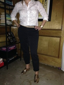 Patterned white button down blouse, cuffed black pants, nude skinny belt, gold oxfords