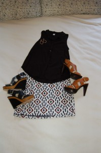 Silk black sleeveless button down; Geometric, sequin print mini skirt; Black wedges or Tan platform heels