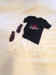 Gray graphic tee, white crochet skirt, brown flip flops