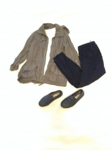 Olive green jacket, white v-neck tee, cropped black pants, black slip ons