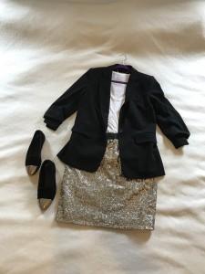 Black 3/4 sleeve blazer, white v-neck tee, gold sequined skirt, gold capped black flats