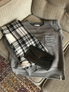 Blanket scarf, grey Krochet Kids sweatshirt, Parker Clay black clutch paired with black leggings and grey Ugg boots